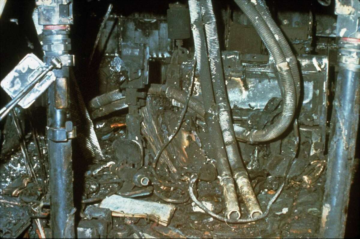 The charred interior of the Apollo I spacecraft shown after the flash fire that killed astronauts Ed White, Roger Chaffee, and Virgil Grissom, January 27, 1967. (AP Photo)
