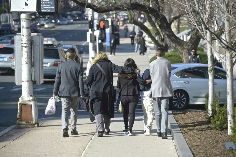 "The family of Constantino ""Tino"" Santiago, wife Norma and sons Jordan, Jayden and Jason leave the Abraham A. Ribicoff United States Court House in Hartford, Conn, on Wednesday afternoon with family friend Judy Wolff. Photo: H John Voorhees III / Hearst Connecticut Media / The News-Times"