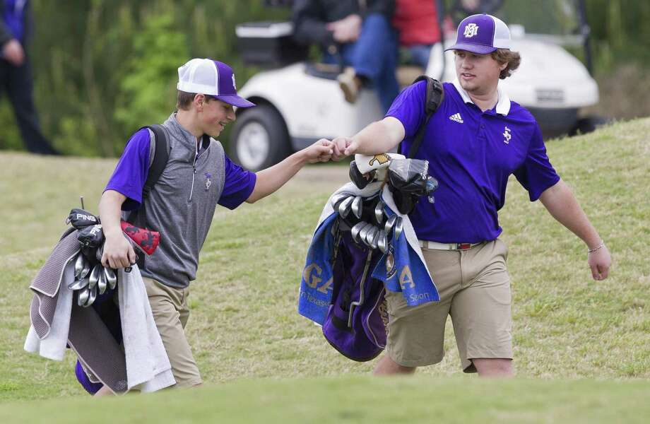 Eyan Edsall of Montgomery, left, gives a fist bump to teammate Cade Walker during the final round of the District 20-5A championships on Wednesday, April 3, 2019, in Magnolia. Photo: Jason Fochtman,  Houston Chronicle / Staff Photographer / © 2019 Houston Chronicle