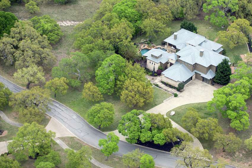 Charles Wheeler's Anaqua Springs Ranch home is seen in a Tuesday, April 3, 2019 aerial image. The home is where authorities found Wheeler's girlfriend, 37-year-old Nichol Olsen, and her two daughters, 16-year-old Alexa Montez and 10-year-old London Bribiescas, shot to death. The medical examiner ruled the children's deaths homicides and ruled Olsen had killed herself though many of Olsen's friends have rejected any possibility that she would harm herself or her children.