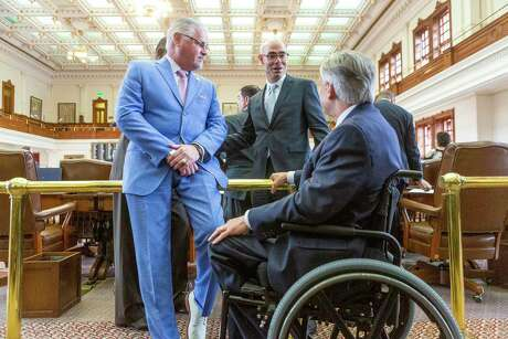 State Rep. Dan Huberty, R-Houston, Speaker of the House Dennis Bonnen, R-Angleton, and Gov. Greg Abbott speak on the floor of the House Chamber before discussion begins on House Bill 3 at the Texas Capitol in Austin, Wednesday, April 3, 2019.(Stephen Spillman / for Express-News)