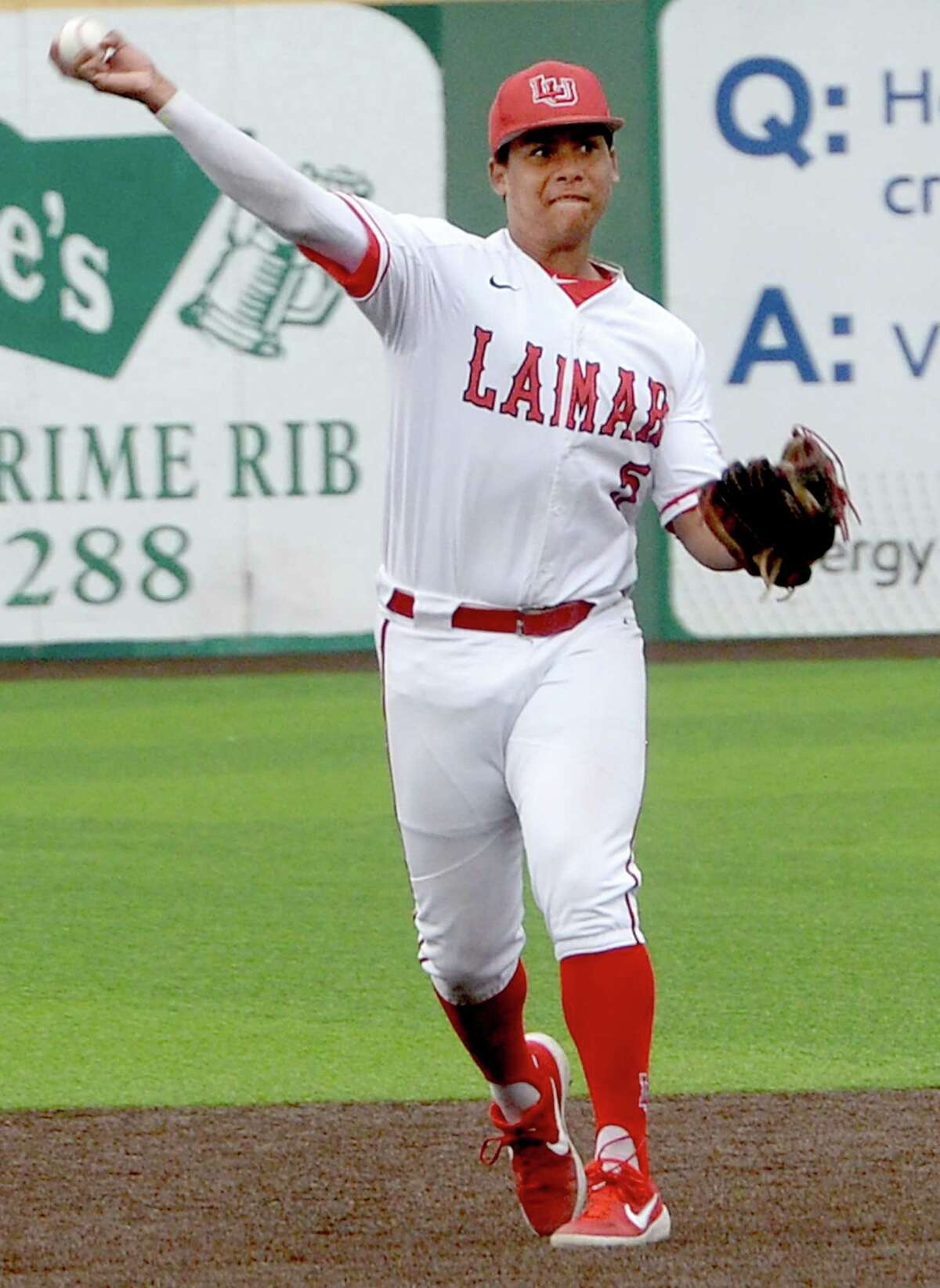 Lamar's J. C. Correa throws to first for the out against Houston Baptist Wednesday. It is the Port Neches - Groves star pitcher's first collegiate appearance. Photo taken Wednesday, April 3, 2019 Kim Brent/The Enterprise