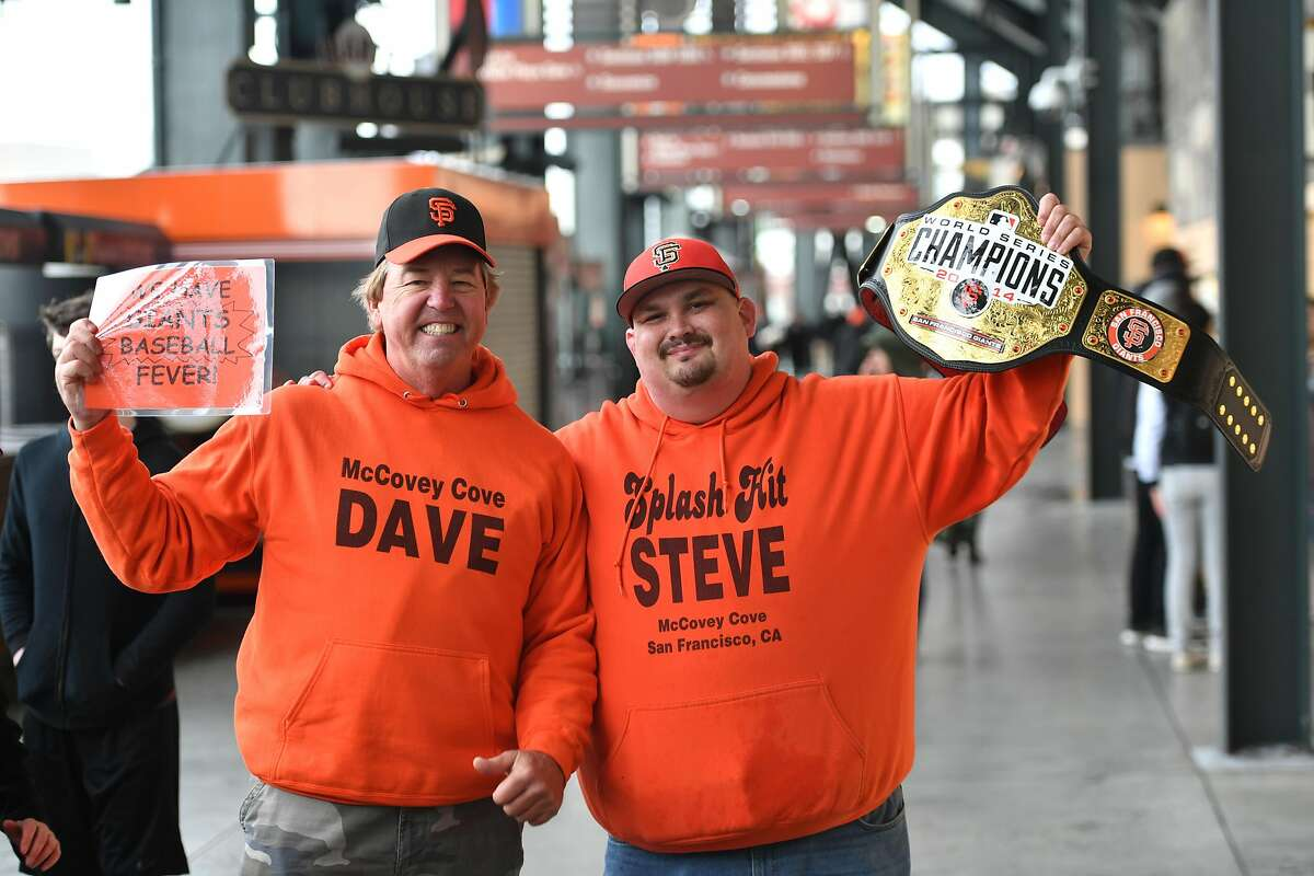 Fans who gave their names as Dave and Steve pose for a photo during the Giants' FanFest at the ballpark event at Oracle Park in San Francisco on February 09, 2019. In spite of rainy weather, fans arrived in force to meet players and get their paraphernalia autographed.