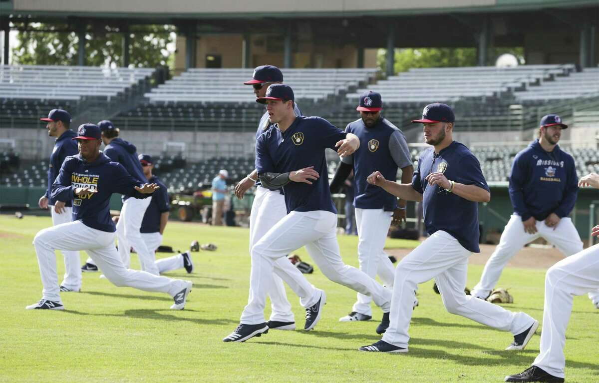 Pitcher Zack Brown, center, goes through stretching exercises with teammates as the San Antonio Missions workout at Wolff Stadium on April 2, 2019.