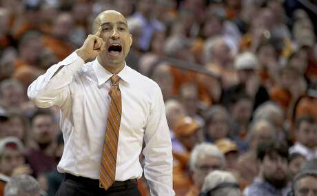 Texas coach Shaka Smart shouts to his players during an NCAA college basketball game against Colorado in the quarterfinals of the NIT on Wednesday, March 27, 2019, in Austin, Texas. (Nick Wagner/Austin American-Statesman via AP)