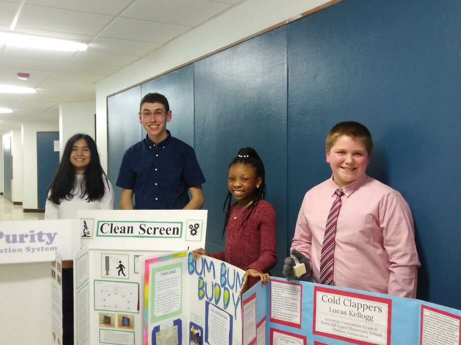 Shelton students Sena Ho, Kyle Young, Kailey Hill and Lucas Kellogg recently gave presentations about their inventions to the Shelton Board of Education. They are among the 14 Shelton students who will take part in the upcoming statewide Invention Convention. Photo: Contributed Photo