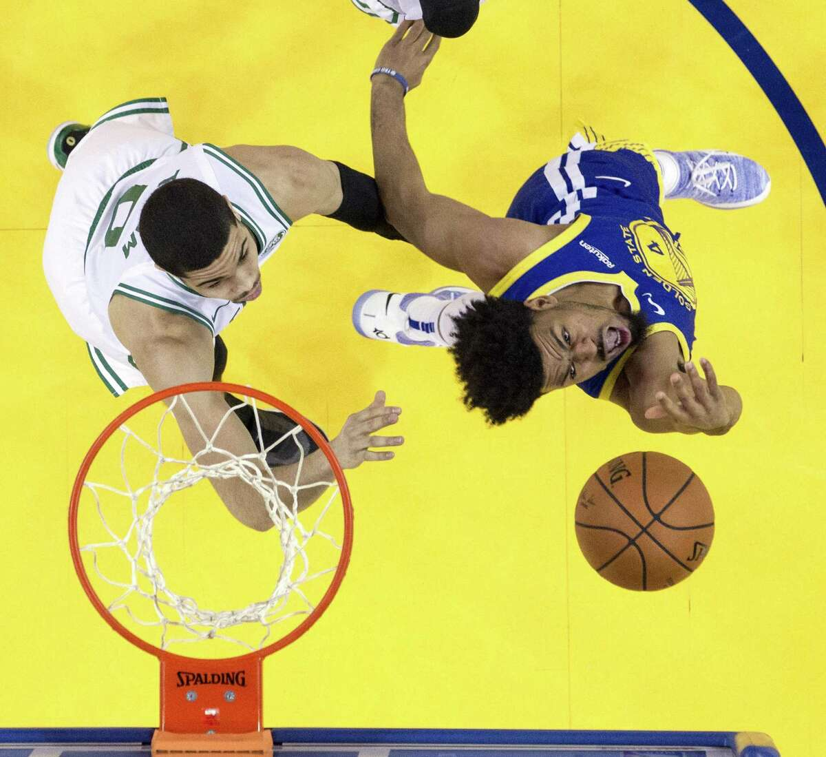Quinn Cook puts up a shot defended by Jayson Tatum in the second half as the Golden State Warriors played the Boston Celtics at Oracle Arena on Tuesday, March 5, 2019.