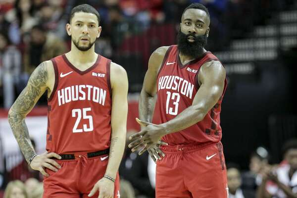 ed8e7fe0be43 1of126PHOTOS  Rockets vs. Jazz Houston Rockets guard James Harden (13)  pulls back Houston Rockets guard Austin Rivers (25) in the fourth quarter  against the ...