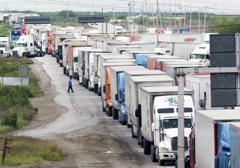 Trucks wait in line on the Mexican Federal Highway Two to cross to the United States from Nuevo Laredo on Wednesday, April 3, 2019. Rapidly growing energy exports helped the Port of Laredo to overtake the Port of Los Angeles as the number one trade hub in the United States. Photo: Marie D. De Jesús, Houston Chronicle / Staff Photographer / © 2019 Houston Chronicle