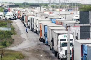 Trucks wait in line on the Mexican Federal Highway Two to cross to the United States from Nuevo Laredo on Wednesday, April 3, 2019. Rapidly growing energy exports helped the Port of Laredo to overtake the Port of Los Angeles as the number one trade hub in the United States. It remains to be seen how the Trump administration's reshuffling of customs officers in April will affect those trade numbers.