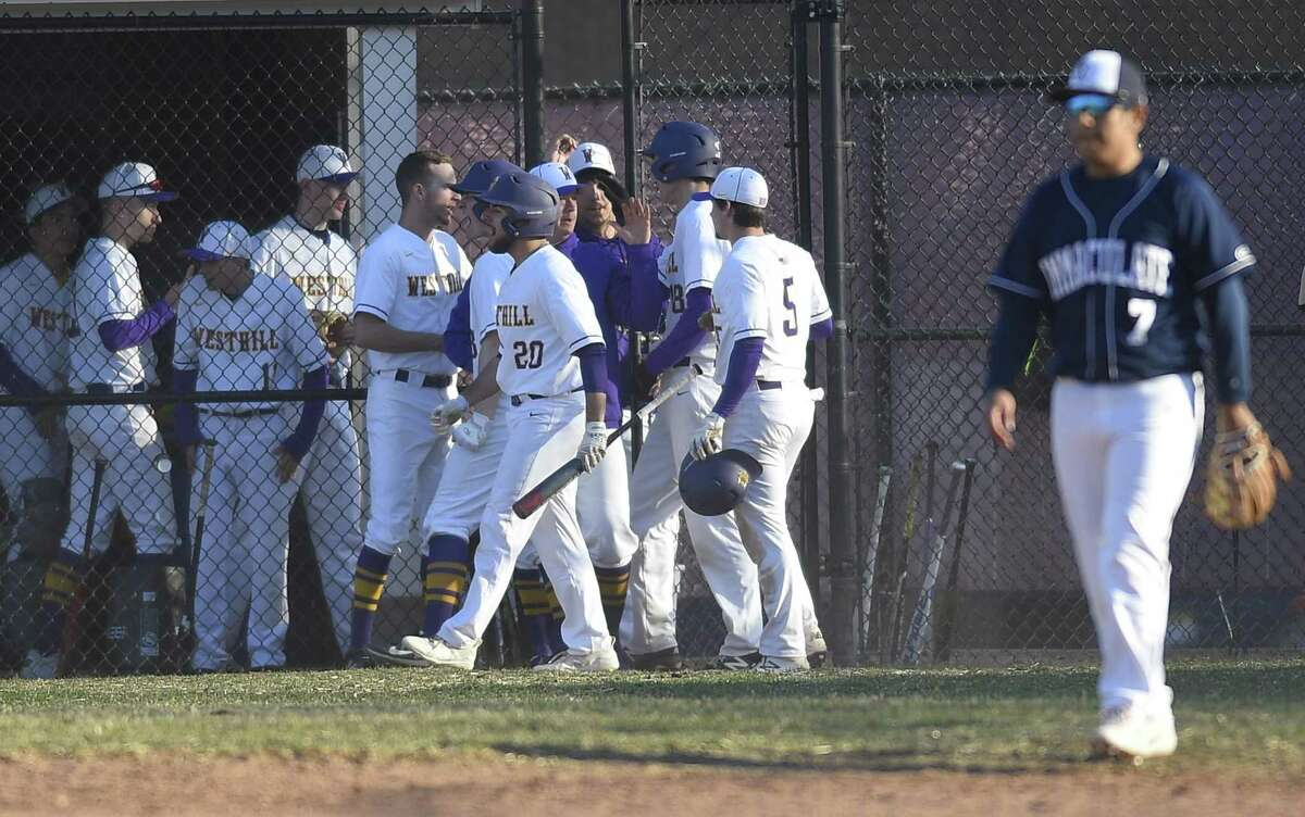 Westhill celebrates a two-run RBI single by Montana Semmel during the bottom of the fourth inning of the Vikings baseball season opener against Immaculate Wednesday, April 3 ,2019 in Stamford, Connecticut. Westhill defeated Immaculate 8-7.