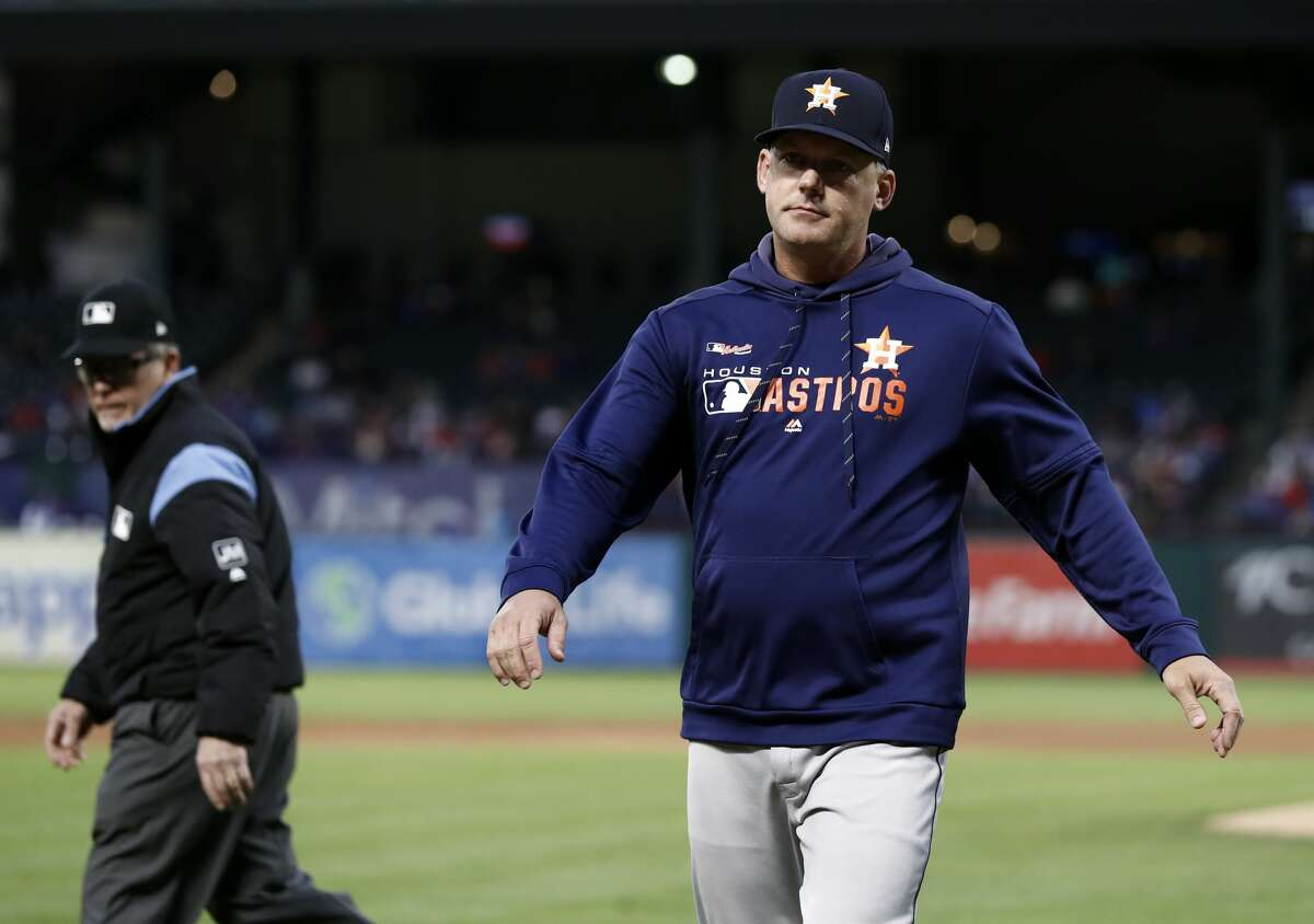 Crew Chief Jerry Meals, left, watches as Houston Astros' AJ Hinch walks back to the dugout after an argument between Hinch and home plate umpire Ron Kulpa in the second inning of a baseball game in Arlington, Texas, Wednesday, April 3, 2019. (AP Photo/Tony Gutierrez)