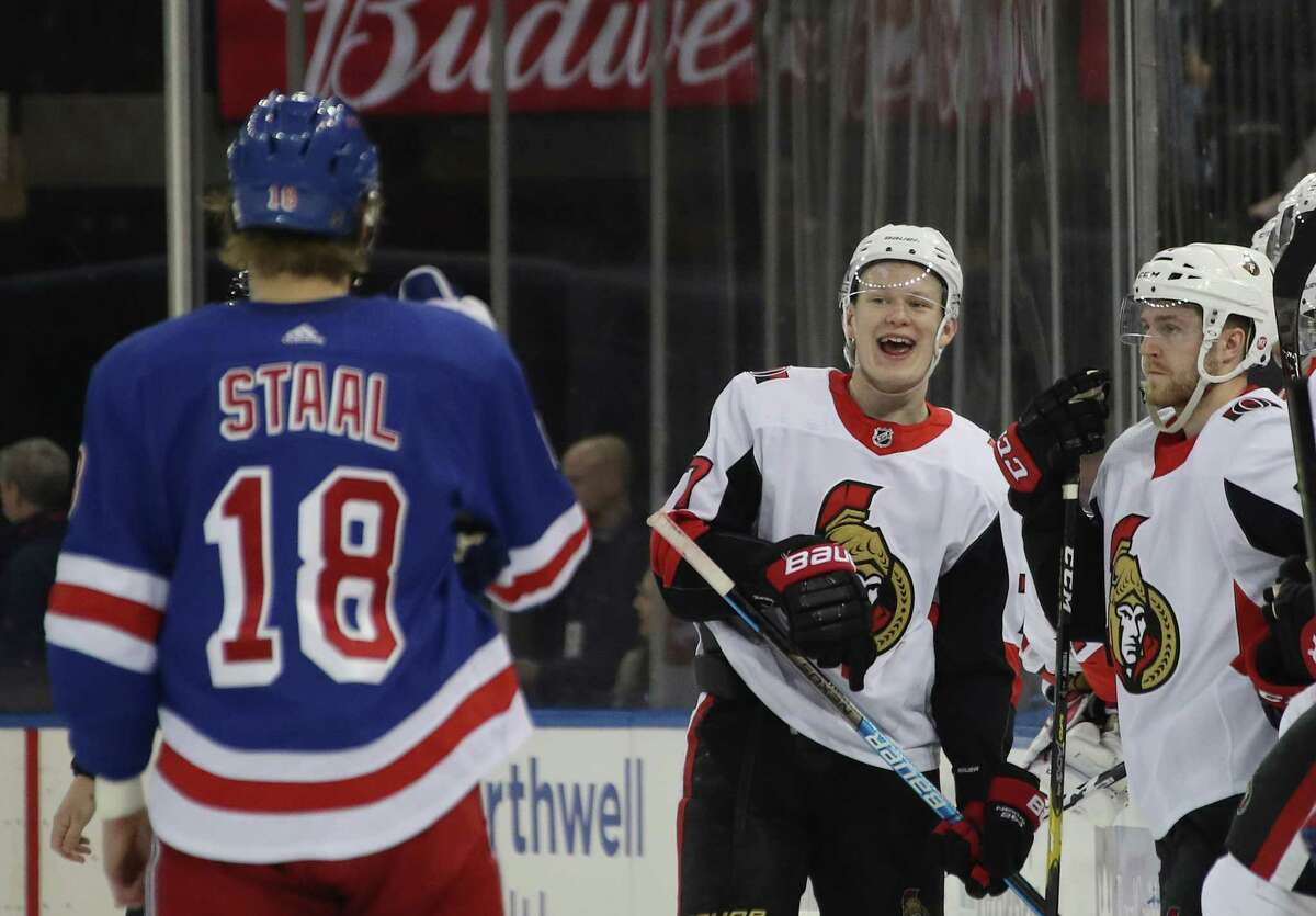 NEW YORK, NEW YORK - APRIL 03: Marc Staal #18 of the New York Rangers and Brady Tkachuk #7 of the Ottawa Senators exchange qords in the final minute of play at Madison Square Garden on April 03, 2019 in New York City. The Senators defeated the Rangers 4-1. (Photo by Bruce Bennett/Getty Images)