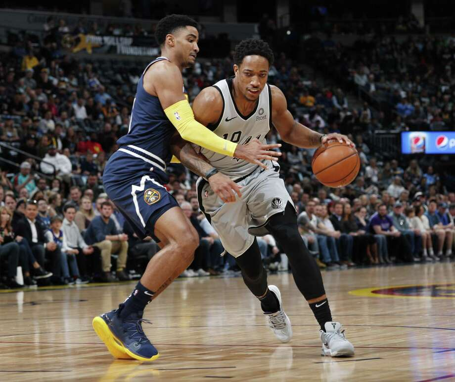 DeMar DeRozan works on Nuggets guard Gary Harris. DeRozan scored just 11 points — more than 10 below his season average — as the Spurs trailed wire-to-wire. Photo: David Zalubowski /Associated Press / Copyright 2019 The Associated Press. All rights reserved.