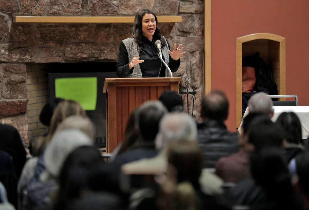 San Francisco Mayor London Breed tries to stop audience members from shouting as she addresses the crowd at the Delancey Street Foundation auditorium where city officials and neighborhood residents discussed a proposed navigation center for the homeless in San Francisco, Calif., on Wednesday, April 3, 2019.