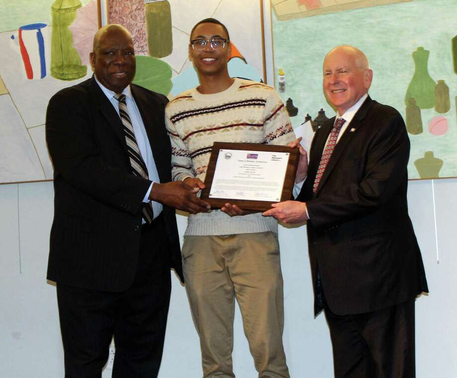 "Staples High School senior Chet Ellis won first place in the 2019 TEAM Westport Teen Diversity Essay Contest for his essay, ""The Sound of Silence."" Ellis is show here with TEAM Westport Chair Harold Bailey (left) and Westport First Selectman Jim Marpe (right) at the contest awards ceremony at the Saugatuck Congregational Church on April 3. Photo: Sophie Vaughan / Hearst Connecticut Media / Westport News contributed"