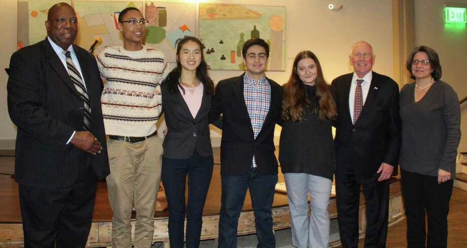 The winners of the 2019 TEAM Westport Teen Diversity Essay Contest post with TEAM Westport Chair Harold Bailey (far-left), Westport First Selectman Jim Marpe (second from right) and Jocelyn Barandiaran, Sr. Vice President of the Westport Library Board (far-right) at the contest's awards ceremony at th Saugatuck Congregational Church on April 3. From left to right the winners were Chet Ellis, first place, Angela Ji, second place, Daniel Boccardo, third place, and Olivia Sarno, honerable mention. Photo: Sophie Vaughan / Hearst Connecticut Media / Westport News