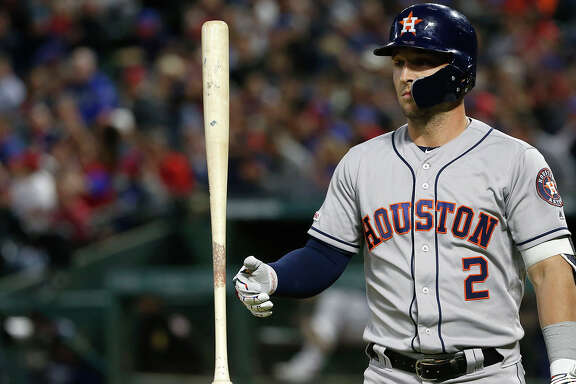The Houston Astros' Alex Bregman twirls his bat after striking out against the Texas Rangers during the third inning at Globe Life Park in Arlington on Wednesday, April 3, 2019, in Arlington, Texas. The Rangers won, 4-0. **FOR USE WITH THIS STORY ONLY** (Ron Jenkins/Getty Images/TNS)
