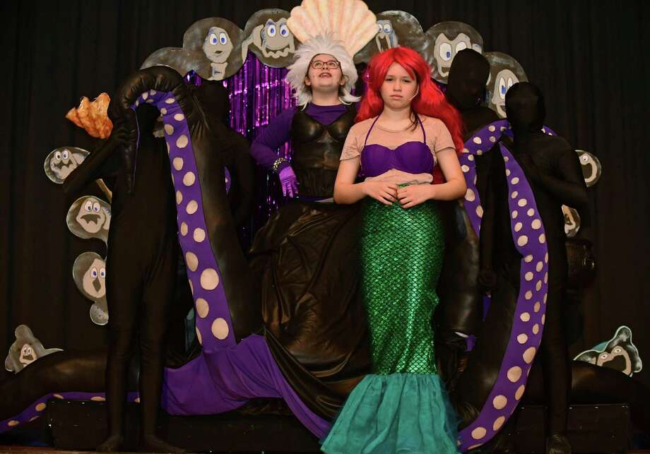 "Eighth-grader Emily Lamphier plays Ursula and seventh-grader Amy Martinez play Ariel as they perform the number ""Unfortunate Souls,"" during the dress rehearsal for the All Saints Catholic School Drama Club production of The Little Mermaid on Wednesday.  Below, seventh-grader Ryan Costikyan plays Flounder in the number ""She's in Love."" Photo: Erik Trautmann / Hearst Connecticut Media / Norwalk Hour"