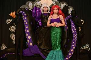 "Eighth-grader Emily Lamphier plays Ursula and seventh-grader Amy Martinez play Ariel as they perform the number ""Unfortunate Souls,"" during the dress rehearsal for the All Saints Catholic School Drama Club production of The Little Mermaid on Wednesday.  Below, seventh-grader Ryan Costikyan plays Flounder in the number ""She's in Love."""