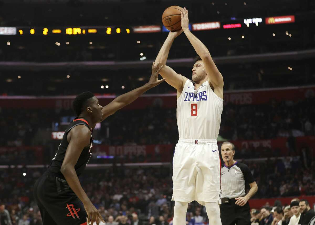 Los Angeles Clippers' Danilo Gallinari (8) shoots over Houston Rockets' Clint Capela during the first half of an NBA basketball game Wednesday, April 3, 2019, in Los Angeles. (AP Photo/Marcio Jose Sanchez)