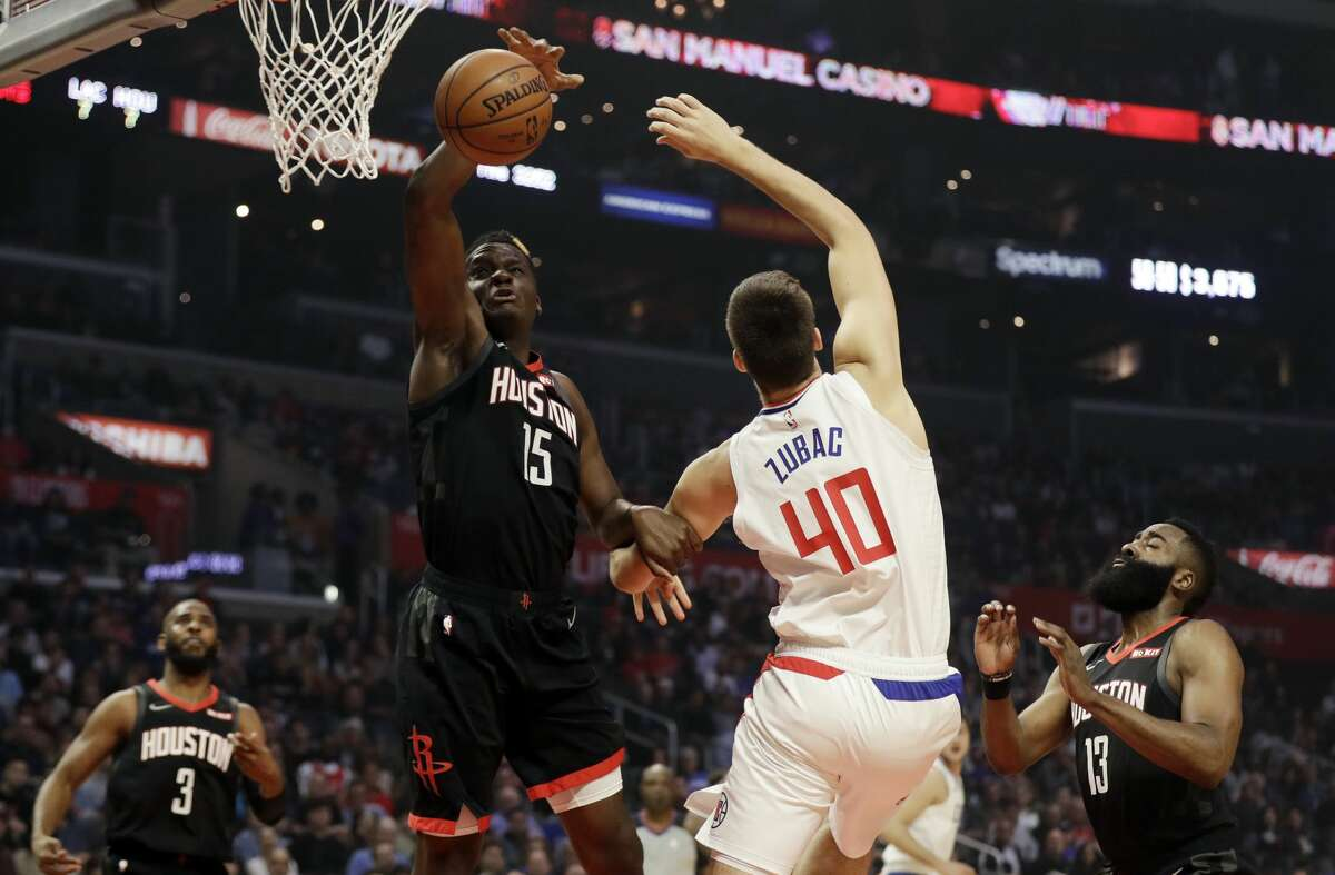 Houston Rockets' Clint Capela (15) grabs a rebound next to Los Angeles Clippers' Ivica Zubac (40) during the first half of an NBA basketball game Wednesday, April 3, 2019, in Los Angeles. (AP Photo/Marcio Jose Sanchez)