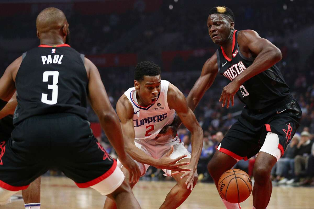 LOS ANGELES, CALIFORNIA - APRIL 03: Shai Gilgeous-Alexander #2 of the Los Angeles Clippers loses the ball on the drive against Clint Capela #15 of the Houston Rockets during the first half at Staples Center on April 03, 2019 in Los Angeles, California. NOTE TO USER: User expressly acknowledges and agrees that, by downloading and or using this photograph, User is consenting to the terms and conditions of the Getty Images License Agreement. (Photo by Yong Teck Lim/Getty Images)