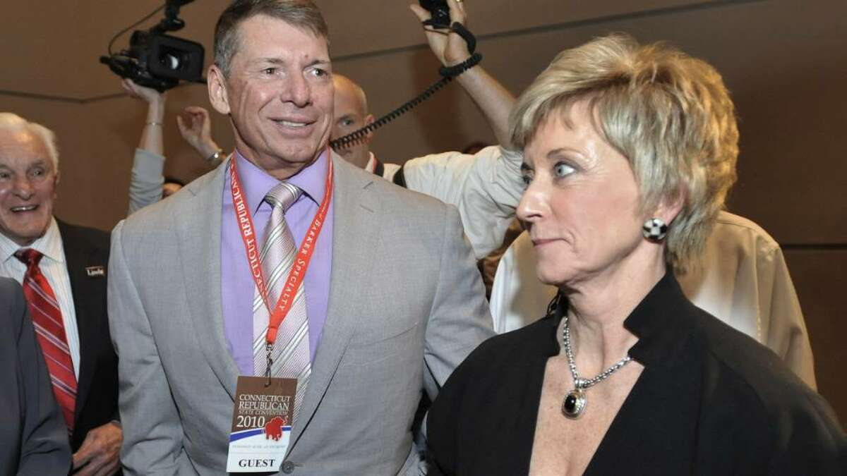 In this May 21, 2010 file photo, Republican candidate for U.S. Senate Linda McMahon, right, and husband Vince McMahon, left, wait for delegate totals to be tallied during the Republican nomination at the Connecticut Republican Convention in Hartford, Conn. The widow of a World Wrestling Entertainment performer who died in a 1999 stunt says she's suing the Connecticut-based company and its leaders, including Republican U.S. Senate candidate Linda McMahon. Martha Hart, widow of Owen Hart, plans to file her lawsuit Tuesday, June 22, 2010, in U.S. District Court in Hartford.