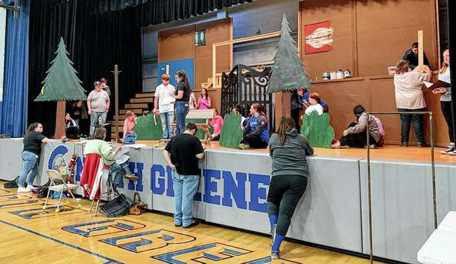 """The stage at North Greene High School in White Hall bustles with activity Monday as rehearsals continue amid ongoing set construction ahead of this weekend's opening of the school's spring musical, """"The Addams Family Musical."""" Photo: Photo Provided"""