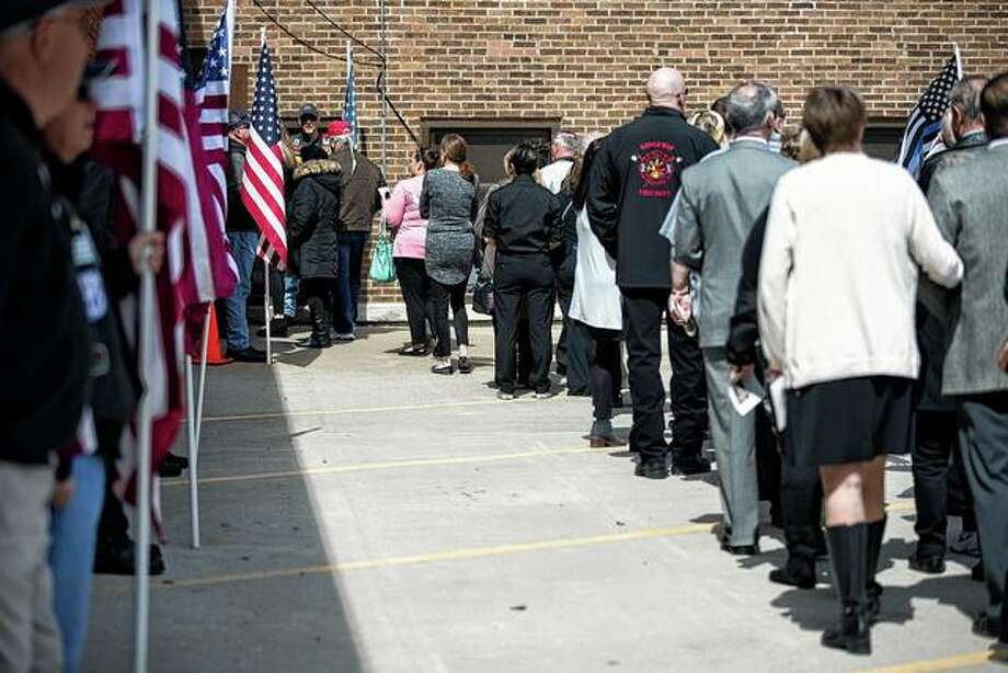 People line up Wednesday to attend the funeral for Illinois State Police Trooper Brooke Jones-Story at Warren High School in Warren. Jones-Story died March 28 in a crash along Route 20 near Route 75 in Freeport. She was a 12-year veteran of the state police. Photo: Scott P. Yates | Rockford Register Star Via AP