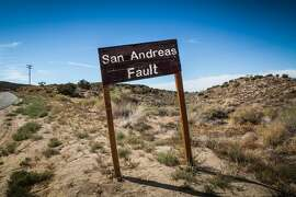 A sign posted where the San Andreas Fault intersects with Pallet Creek Road in Pearblossom California, a small town in Los Angeles County.