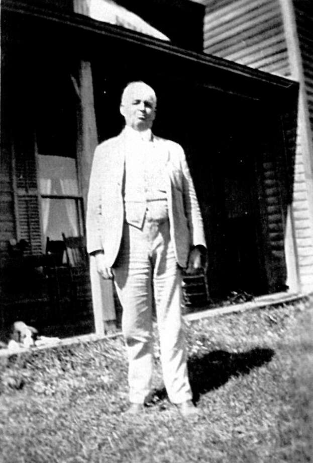 This is Frank Wixom standing in front of the Elisha Day home purchased by the Hayhurst family of Detroit. Extensively remodeled, it was home for James Hayhurst and his daughter Maude, Frank Wixom, Amos Secor (construction superintendent), a housekeeper and cook, and a few men who worked on the farm.