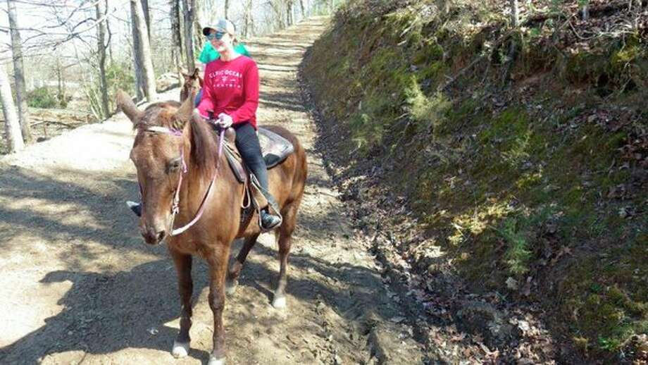Below, the writer's granddaughter, McKenna Lounsbury, 15, thoroughly enjoyed her horseback ride onwooded trails in the Great Smoky Mountains. (Tom Lounsbury/Hearst Michigan)