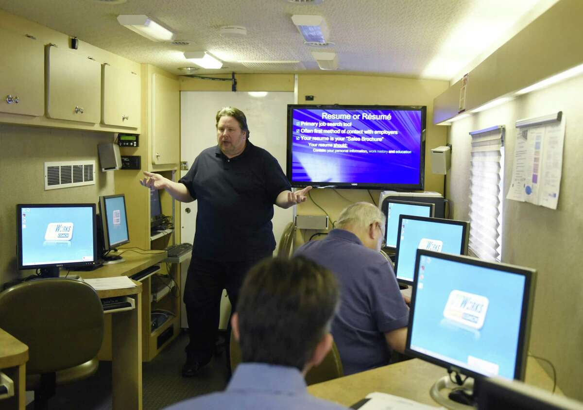 Dennis Ahearn leads a resume workshop in October 2018 in Greenwich, Conn., in his role as a career coach with the Connecticut Department of Labor and its CTWorks program.