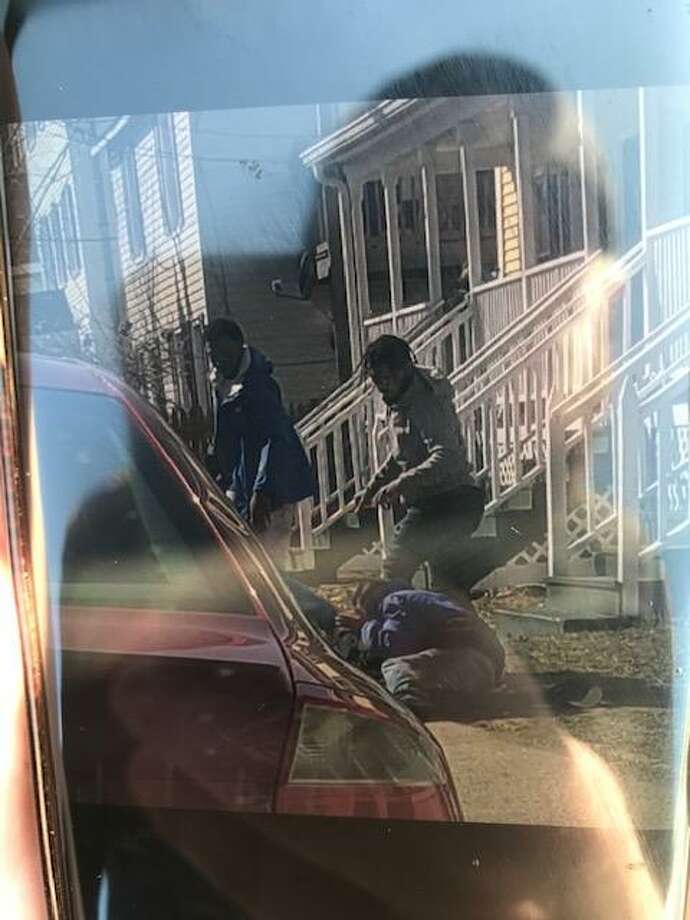 Police have released this photo of three men kicking and stomping a 40-year-old man during a robbery attempt in the South End on April 3, 2019. Photo: Stamford Police / JContributed