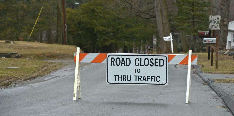 File photo of a road closure sign. Photo: H John Voorhees III / Hearst Connecticut Media / The News-Times