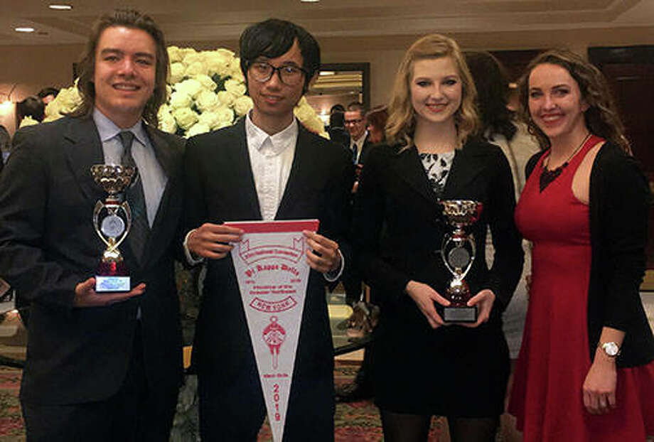 Greg Saiki (from left), Ye Htet, Donna Jenkins and Illinois College debate and speech head coach Shawna Merrill show their awards from the 2019 Pi Kappa Delta Biennial National Convention and Tournament. Photo: Photo Provided