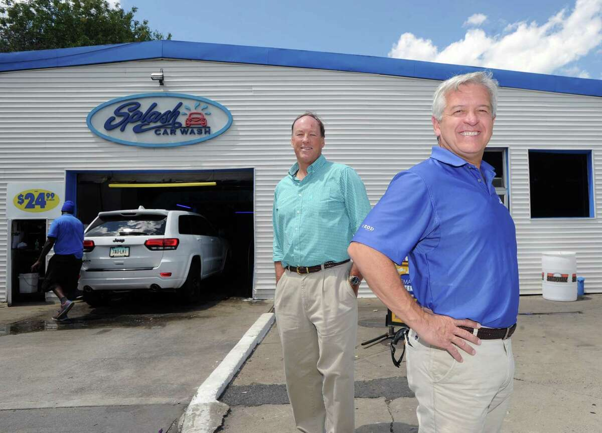Splash Car Wash owners Chris Fisher, left, and Mark Curtis, stand outside their car wash at 625 W. Putnam Ave. in Greenwich, Conn., on July 22, 2015.