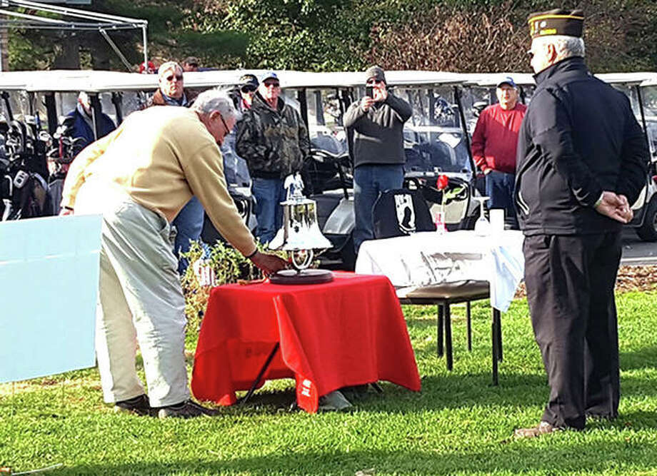 In this photo from the 2017 Veterans Day Scramble at Oak Brook Golf Club, participants were invited to ring a bell, borrowed from the Edwardsville Fire Department, in honor of fallen veterans. The Veterans Day 2018 Makeup Scramble will be held April 13 at Oak Brook after the 2018 tournament was postponed twice due to the weather. Photo: For The Intelligencer