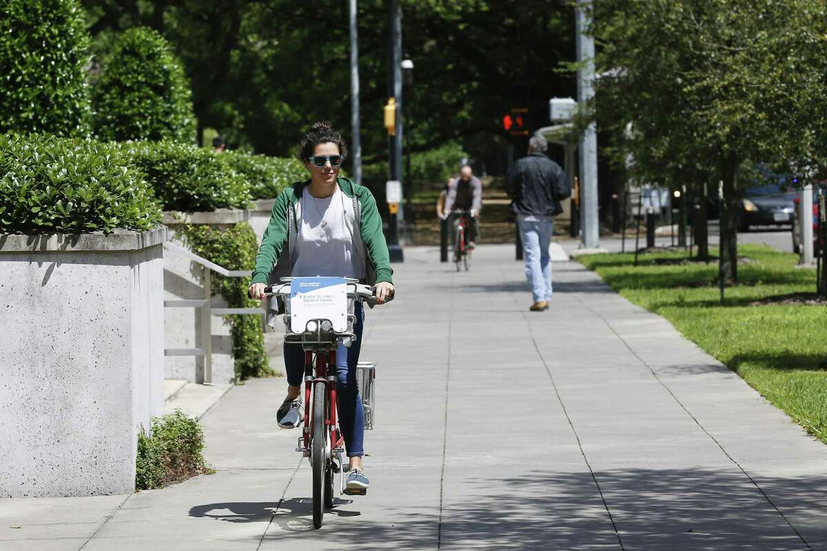 """""""I use it all the time to go and get coffee or to run quick errands"""" Gisele Caleron said as she checked out a B-Cycle bike sharing system bike in the Texas Medical Center on April 2."""