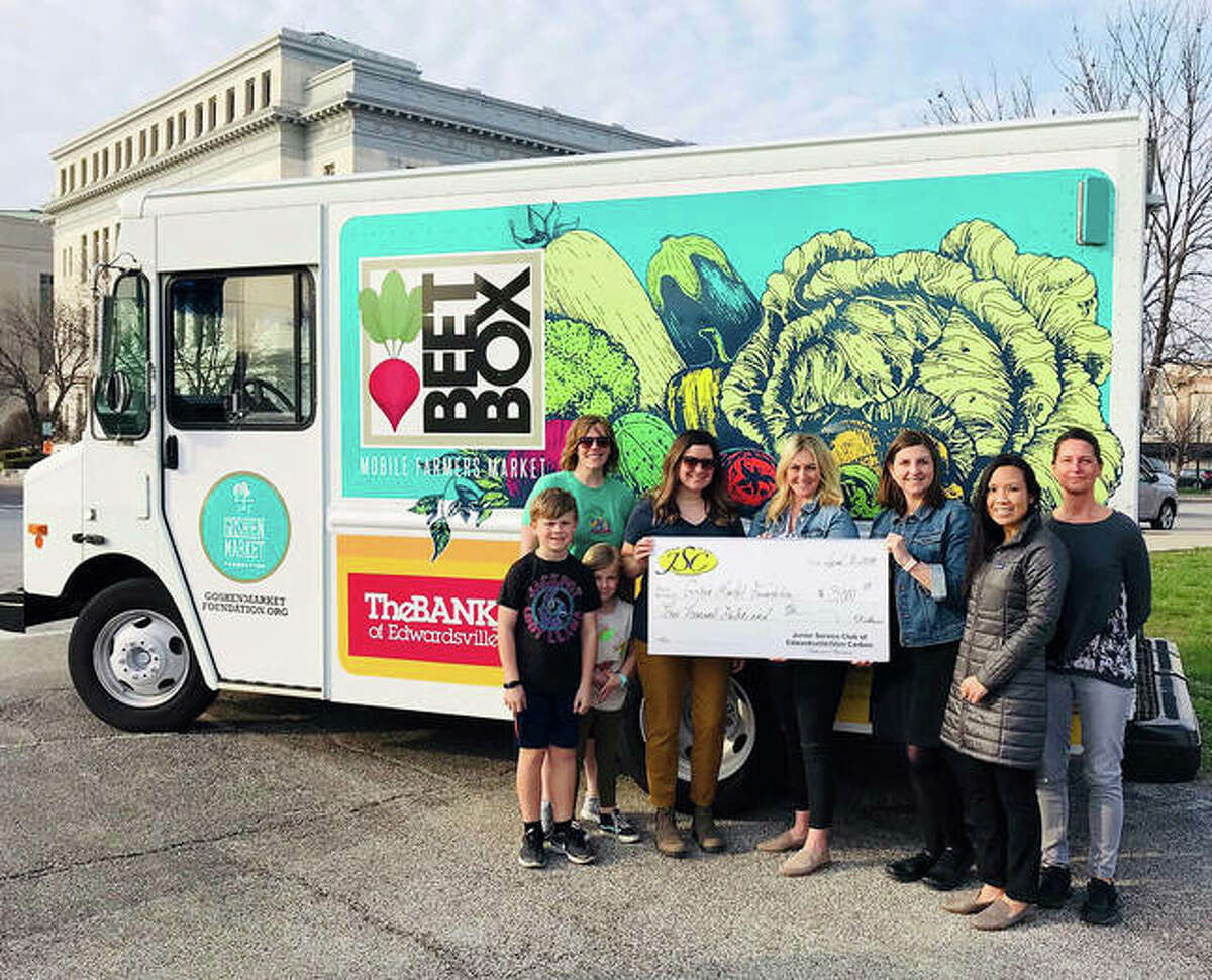 In front of the Beet Box, the Goshen Market Foundation's food truck is Tara Pohlman with Goshen Market Foundation, Emily Morrison with Goshen Market Foundation, Sarah Dawson, JSC President, Andrea Walsh, JSC community relations chair, Judy Blaskie and Karol Hatton. The Madison County Courthouse is in the background.