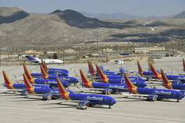 Southwest Airlines Boeing 737 Max planes are parked on the tarmac after being grounded.