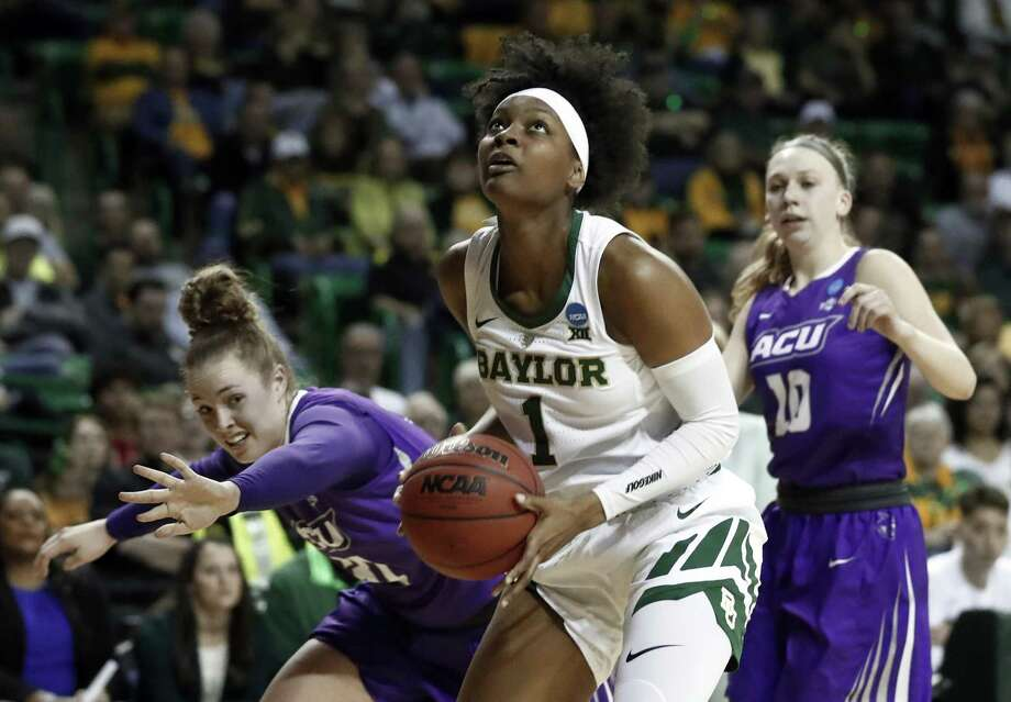 Baylor forward NaLyssa Smith (1) gets pst Abilene Christian guard Madi Miller, left, and Breanna Wright (10) for a shot opportunity in the second half of a first-round game in the NCAA women's college basketball tournament in Waco, Texas, Saturday March 23, 2019. (AP Photo/Tony Gutierrez) Photo: Tony Gutierrez, STF / Associated Press / Copyright 2019 The Associated Press. All rights reserved.