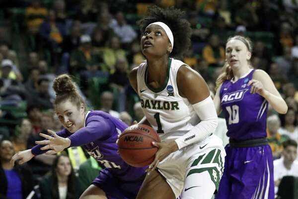 Baylor forward NaLyssa Smith (1) gets pst Abilene Christian guard Madi Miller, left, and Breanna Wright (10) for a shot opportunity in the second half of a first-round game in the NCAA women's college basketball tournament in Waco, Texas, Saturday March 23, 2019. (AP Photo/Tony Gutierrez)