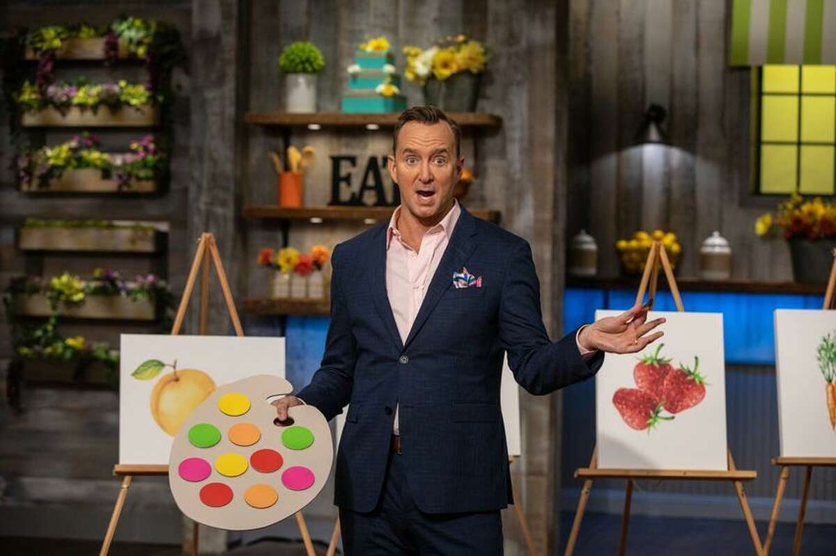 Host Clinton Kelly announces the rules of the challenge for the main heat, water color cakes, as seen on Spring Baking Championship, Season 5.