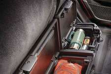 Folding up the Gladiator's rear seat cushions reveals Jeep's clever storage bin. (Jeep photo)