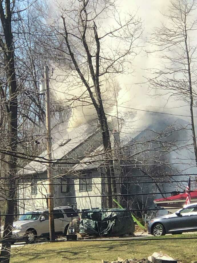 A home on Route 39 in New Fairfield caught on fire Thursday afternoon. Photo: Contributed Photo / The News-Times Contributed