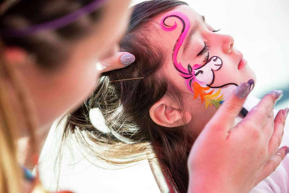 Scarlett Beguerisse has the finishing touches applied to her unicorn face paint during the 35th Annual Good Oil Days on March 28, 2015, on Main Street in Humble.
