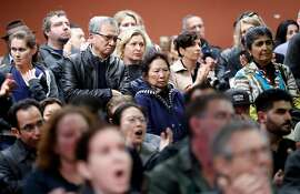 Crowd members react to an area resident speaking out against Embarcadero SAFE Navigation Center during informational meeting at Delancey Street Foundation in San Francisco, Calif., on Tuesday, March 12, 2019.