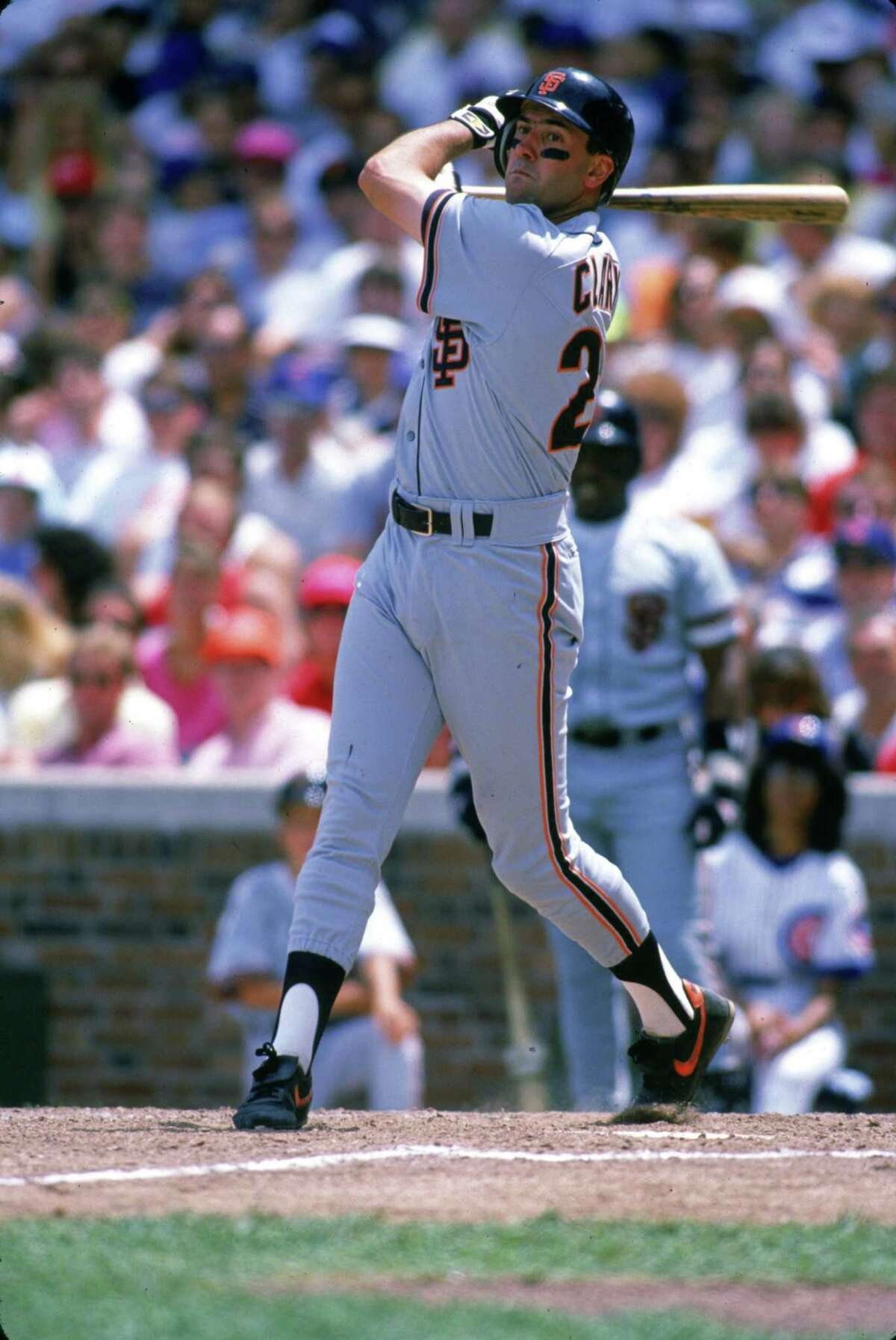 Will Clark of the Giants bats during a game at Wrigley Field in Chicago.
